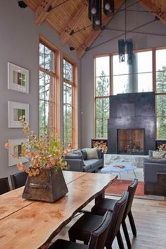 I love everything about this: the fact that it's in Tahoe, the high ceilings with glass and wood paneling, the raw edge dining table...