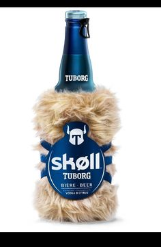 creative advertising - viking coat for beer bottle ~ name Tuborg comes from Thuesborg / 'Thues Castle', Copenhagen inn from 1690's situated in the area of the brewery; Tuborg the Scandinavian has recreated a viking beer, aromatized with vodka & citrus fruit, Skøll has an instant freshness which will make people shout Skøøøøll !! [battle shout - originated from meaning 'bowl' - to victims' skulls in 17thC.];  Beer Danish +  bearing the distinctive thorkill | viking helmet