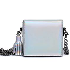 Holographic flap shoulder bag with fringe tassel, metal gun hardware & chain strap. In colors Pastel Pink, Neon Pink & Silver. Measures in CM by 15cm L x 7cm W x 15cm H Ships from New York City in 3da