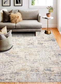 Take a breath and relax with the calming, earthy tones of this rug by Bashian. We are suckers for a beige and gray combo! #plushrugs #graydecor #beigedecor #arearug #livingroominspo #livingroomdecor #graycouch #earthydecor #dimensionaldecor #calm #subtledecor