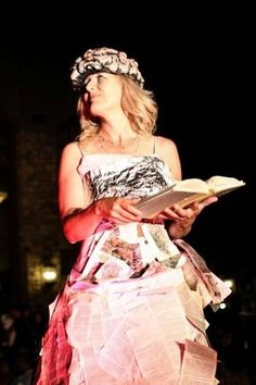 The perfect dress for the bibliophile. It's made of all recycled materials, including hundreds of pages from books. The brain helmet drives the point home. It debuted at Monte de Oro Winery during the Earth Day fashion show in Temecula.