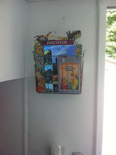 Simple idea, but works great if you are camping with kids!  We added a magazine rack and stocked it with kids' books for easy storage.