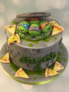 TMNT Teenage Mutant Ninja Turtles birthday celebration cake with slime, drain and pizza