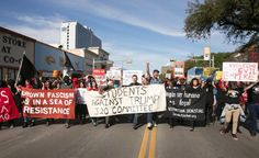 Anti-Donald Trump protesters block traffic as they march in the middle of Guadalupe Street at UT on Inauguration Day, Friday, Jan. 20, 2017.