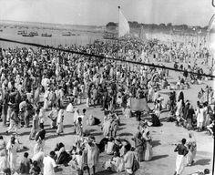 Crowds of pilgrims on the waterfront at Allahabad, India during Kumbha Mela