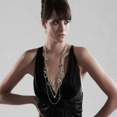 Model Wears - Three Strand Multiple Pearl and Filigree Bead, and Ovals Necklace in Silver. Chain length can be adjusted to suit your style. From £130.