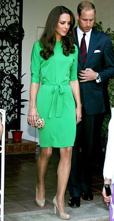 belted emerald green dress and a leopard-print clutch