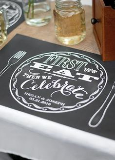 """Celebrate your nuptials with a chalkboard theme right down to the place setting at the reception! Chalkboard-style placemats display an illustrated place setting design and feature the wording """"First we eat, then we celebrate"""" printed inside the plate design. Features and Facts:  Set of 25.  Measures: 17"""" W x 11"""" H.  Material: White smooth 45 lb. paper.  Personalization: Enter two lines of personalization such as Bride and Groom's names on Line 1 (up to 16 characters, including spaces) ..."""