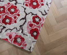 A wonderful contemporary floral rug. Spring Fair was developed from me photographing blossom on my back under a great bower of blooms. The colours of spring blossom are so transient that my desire to record them in my work became essential.