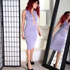 """DEITY"" LACE-UP MIDI DRESS  $34.00  Lavender is usually a relaxing and soothing color. But this dress screams fierce fashion and style.  The crisscross front details of the dress gives the impression that you are confident and sexy. The length of the dress gives a wonderful contrast, though, as the length is just right below the knee. It tells that you are also reserved and in control."