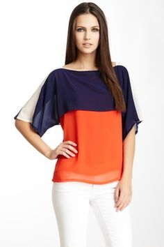absolutely love the style of this top. this would be so figure flattering for me and I NEVER can find figure flattering clothes