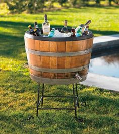 Convert bourbon barrel into a drainable beverage container.