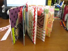 Memory book made out of manilla folders and scrapbook stuff.