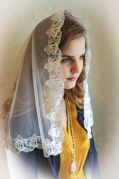 Evintage Veils~ This lovely and light high quality chapel veil is trimmed in super soft embroidered lace, for a contrasting effect, and we simply love it! A D shaped veil, it measures about 38 X 24 inches . Color: Ivory  This veil is also suitable for Confirmation, First Holy Communion, and bridal use. Can be made in smaller size by custom request.  I am including a sewn-in tiny snap comb to keep this beauty firmly in place! And, of course, our complimentary organza bag!  Convo us with any…
