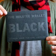The Black Holstee Wallet is inside the envelope. 10% of all sales will go towards Animal Welfare via PETA. The actual wallet is made from upcycled plastic bags collected from the streets of Delhi.