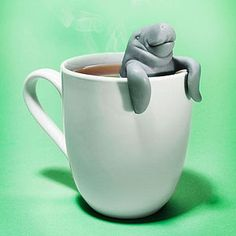The ManaTea Infuser perches on any cup as the tea leaves steep in its tail. SO cute!