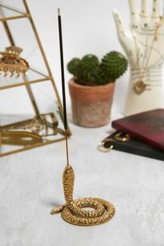 Shop Gold Coiled Snake Incense Holder at Urban Outfitters today. We carry all the latest styles, colours and brands for you to choose from right here. Ceramic Pottery, Pottery Art, Ceramic Art, Diy Clay, Clay Crafts, Insense Holder, Clay Art Projects, Serpent, Air Dry Clay