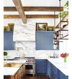 I wish I could wake up and find this kitchen in my house. I didn't even know I wanted blue cabinets?! Seriously as if Brooklyn Decker wasn't already #blessed in the looks department . Sorry I'm bitter. Go see it all for yourself at @mydomaine by bethbarden