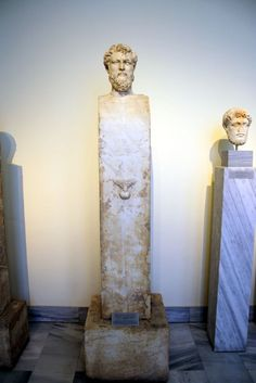 Herm: a squared stone pillar with a carved head on top (typically of Hermes), used in ancient Greece as a boundary marker or a signpost.