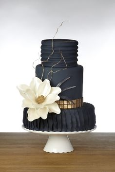 Navy Blue Textured Wedding Cake with White Flower, Stem Detailing and a Gold Band Accent - BEAUTIFUL