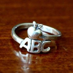 Sterling silver ABC Apple Ring is a great jewelry gift for yourself, a teacher gift, a graduation gift for an education major or teacher app...