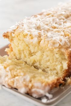 This coconut loaf cake is full of buttery, coconut flavor! It's easy to make and has a 3 ingredient homemade coconut glaze poured over the top. The perfect recipe for spring! Desserts The Best Coconut Loaf Cake Coconut Loaf Cake, Coconut Desserts, Coconut Recipes, Just Desserts, Baking Recipes, Delicious Desserts, Dessert Recipes, Easter Recipes, Coconut Cake Easy