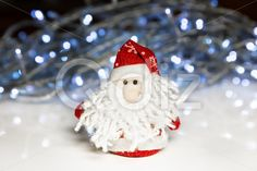 Qdiz Stock Photos | Santa Claus or Father Frost with Christmas lights,  #background #beard #celebration #Christmas #Claus #Clause #closeup #decoration #doll #eve #Father #figure #frost #fun #funny #greeting #holiday #lights #little #Merry #new #red #Santa #small #toy #traditional #white #x-mas #xmas #year