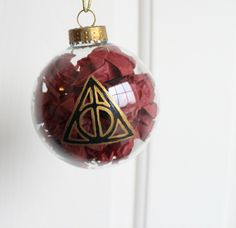 Harry Potter Christmas Ornament Sign of the Deathly Hallows. $13.00, via Etsy.