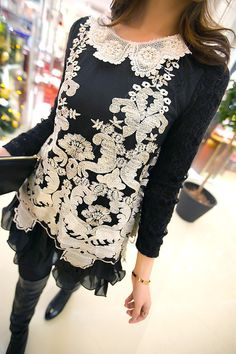 Lovely appliqued lace work makes a dramatic statement.