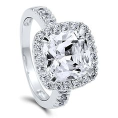 BERRICLE Rhodium Plated Sterling Silver Cushion Cut Cubic Zirconia CZ Halo Engagement Ring Size 7. Metal: rhodium plated .925 sterling silver, nickel free. Main Stone: 3.61 carat cushion cut clear cubic zirconia (9.75mm). Accent Stone: 0.50 carat cubic zirconia. Ring Band Width: 2.5mm.