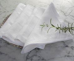 Julia B. Lyon dinner napkins in white linen.