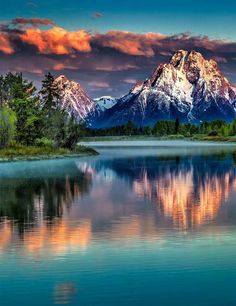 Mount Moran Sunrise [Mount Moran is a mountain in Grand Teton National Park of western Wyoming, USA. The mountain is named for Thomas Moran, an American western frontier landscape artist.] sunset scene, pink and purple clouds Grand Teton National Park, National Parks, Beautiful World, Beautiful Places, Beautiful Scenery, Beautiful Nature Pictures, Beautiful Sky, Amazing Photos, Jolie Photo