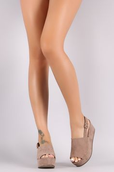 Free SH & Easy Returns! Shop This platform wedge features a peep toe silhouette, wide band across vamp, and a slingback strap with an adjustable buckle fastening.