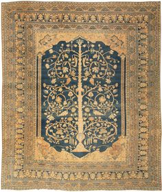 Dorokhsh Rug, Persia, Circa 1900, only $21 000! A graceful, flowering tree of life with spiraling branches spreads across the rich sea blue field of this sumptuous antique Khorassan. Finely proportioned columns support abstractly rendered arches at either end of the field. The relative simplicity and openness of the field contrasts with the closely detailed complexity of the multiple borders, while the consistent use of blue and sandy tones across the carpet provides a unified decorative…