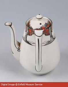 Crown Ducal coffee pot was produced by A.G. Richardson & Co. of Gordon Pottery, Tunstall. It features the famous 'Orange Tree' pattern which was designed by Norman Keates and introduced in 1925
