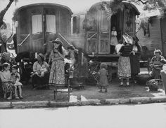 Old and new trailers parked on grounds near the Rhone-gypsy family, where tourists and gypsies live during pilgrimage of Saint Marys-Of-The-Sea. Photograph by Frank Scherschel. France, July 1954.