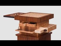 An Art Deco style table with automated movement and a variety of secret drawers and hidden details. There is also a circular spinning puzzle hidden inside th...
