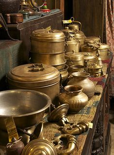 An astonishing collection of brass. Everything from solid door rings to chapati canisters.  Maiwa East
