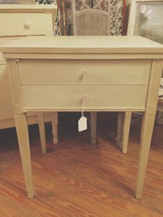 Old sewing machine cabinet I painted with Country Grey and with the clear and dark wax. Simple is better!