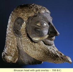 Etruria: With features seemingly combining late archaic and early classical Greek with contemporary Egyptian, Etruscan male head with gold overlay, 700  BC.