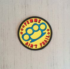 As part of our sale (and whilst stocks last) you can get our Femme Aint Frail patch for only $5 (RRP $7) This is a limited edition embroidered patch measuring 3 in diameter. It can be ironed or sewn on to clothes and accessories.  There is a matching enamel pin available here https://www.etsy.com/listing/399894949/femme-aint-frail-knuckleduster-enamel You can also pick up both the pin and patch as part of a gift set…