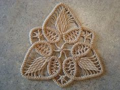 "A few people have asked me about Romanian Point Lace so I thought I would post a tutorial.    Romanian Point Lace Ornament (4"")   I taught m..."