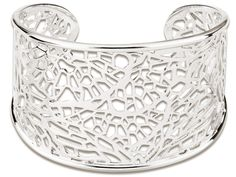 Revamp your look with an accessory that has the power to infuse a mix of modern and enchanting beauty to any ensemble. Sterling silver is fashioned into a cuff bracelet with rounded edges and whose sleek lines enclose an openwork motif of geometric shapes. This elegant ELLE bracelet is sure to become one of your staple accessories.