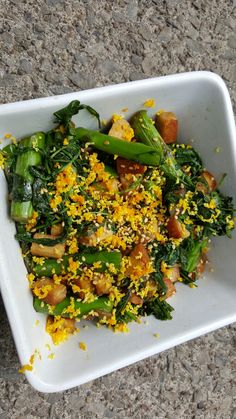 Tofu asparagus kale and grated orange rind