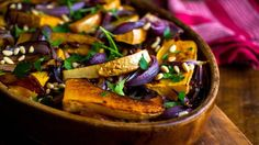 NYT Cooking recipe from Yotam Ottolenghi and Sami Tamimi. Chop up a few red onions and a butternut squash, roast them in high heat, and drizzle them with tahini sauce, herbs and pistachios. Vegetarian Thanksgiving, Thanksgiving Recipes, Thanksgiving Feast, Holiday Recipes, Dinner Recipes, Bon Appetit, Red Onion Recipes, Vegetarian Recipes, Cooking Recipes