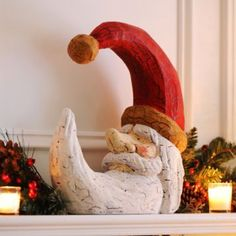 A cute and rustic Crescent Santa Statue is the perfect addition to your home this holiday season! #Kirklands #CozyChristmas #holidaydecor