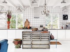 Globally-Inspired Kitchen Design | At her 19th-century home in Höganäs on the coast of Sweden, interior stylist Marie Olsson Nylander subverts the minimal-chic cliché of a pale and contemporary space by using a mix of textures, vintage pieces, and furnishings not normally found in the kitchen.