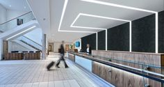 TruGroove Linear Recessed Retail LED Strip Lights that climb up the wall in the work out area and across the ceiling.