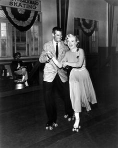 Cary Grant & Marilyn Monroe.On roller skates! Probably an outtake from 'Monkey Business' with Ginger Rogers