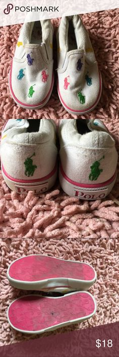 Polo Ralph Lauren, slip on sneakers Multi colored polo horse logo, white canvas sneakers. In pre-loved condition but with lots of wear left! Polo by Ralph Lauren Shoes Sneakers